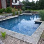 Elegant naturally-styled in-ground swimming pool - perfect for Ottawa summers!