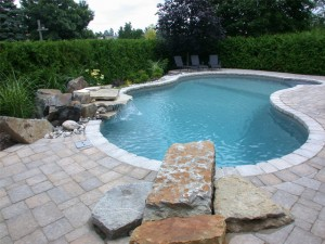 Ottawa swimming pool with diving rock for fun summers