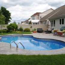 Large curvy in-ground swimming pool in the heart of Ottawa suburbs