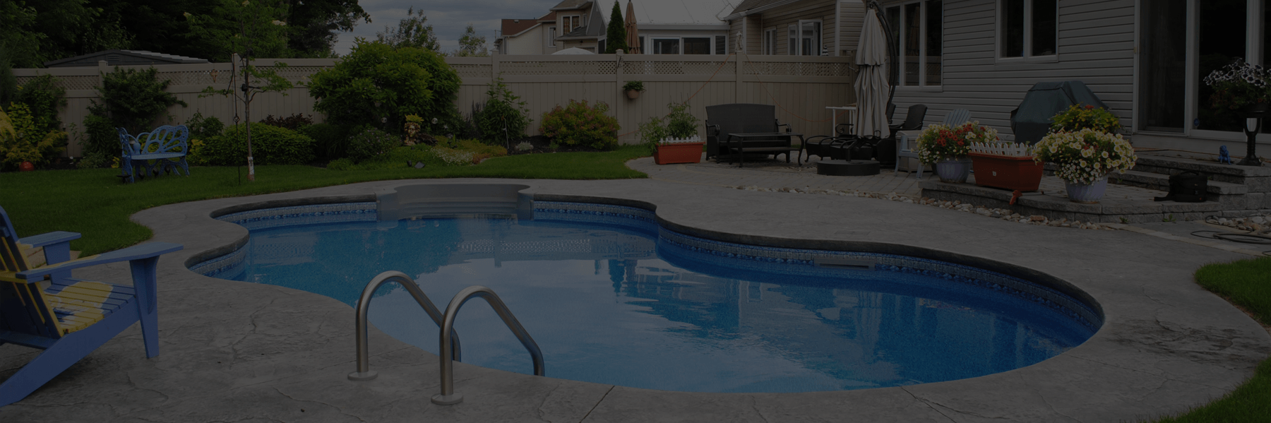 Ottawa backyard featuring kidney shaped swimming pool - dark overlay