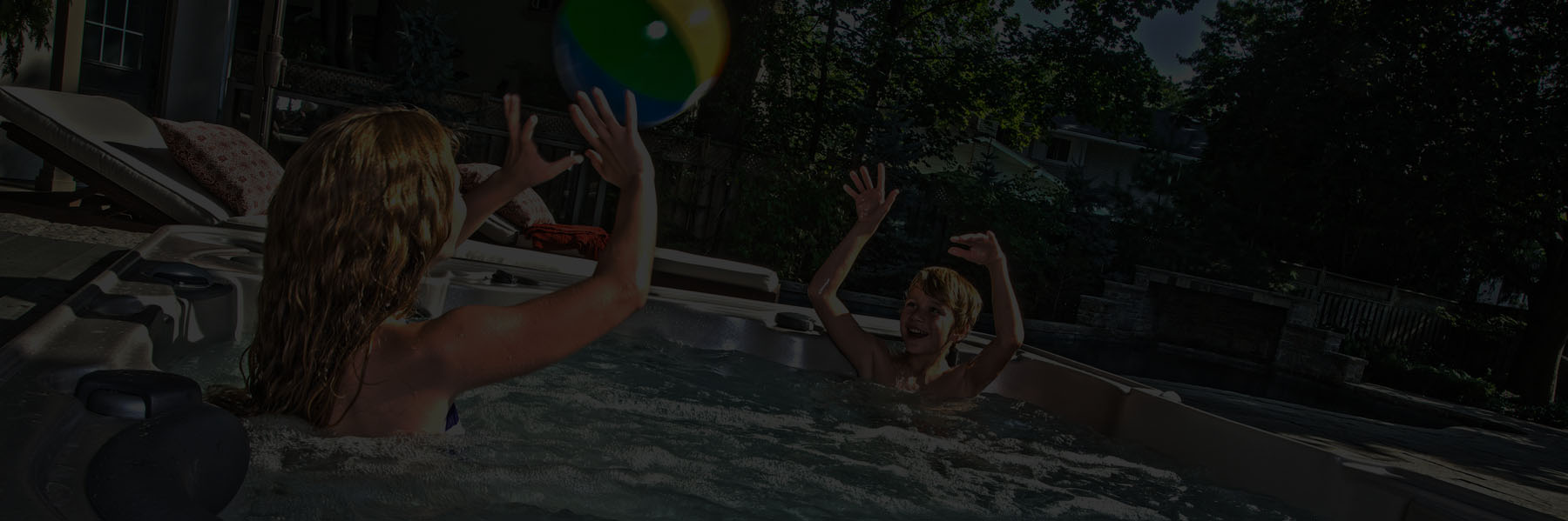 HydraPool hot tub with kids having fun with a beach ball