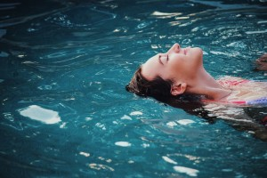 Woman swimming in a semi inground pool this summer.