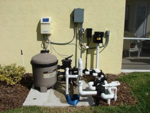 A Hayward pool pump, newly installed next to a home.