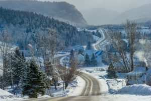 A view of a winding backroad in the middle of a chilly winter.