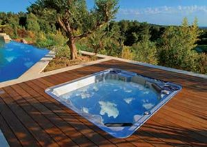 Inset hot tub in a raised decking with beautiful view