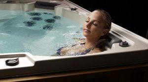 woman relaxing in a HydraPool hot tub