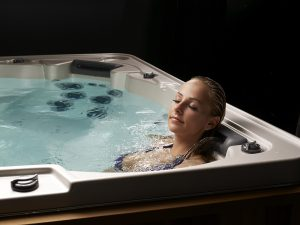 woman relaxing in HydraPool hot tub - square