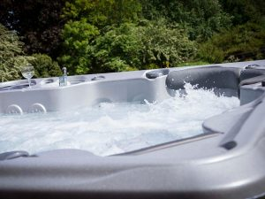 outdoor hot tub on with bubbling jets