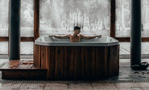 Man uses indoor hot tub