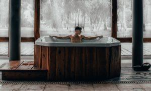 Man uses indoor hot tub