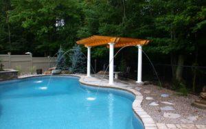 A gazebo beside a pool