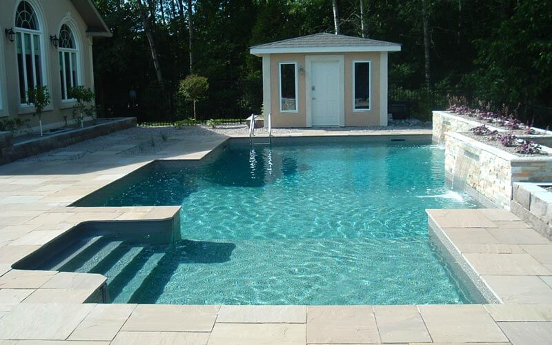 A boxy pool with fountains