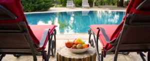 zoomed in photo of 2 lounger seats at poolside