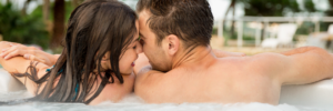 couple smiling and touching foreheads in hot tub